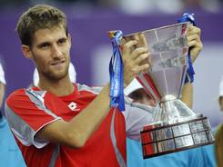 Martin Klizan of Slovakia holds his trophy after defeating Fabio Fognini of Italy in the final of the St. Petersburg Open on Sunday.