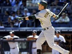 The Athletics' Cliff Pennington follows through on his second-inning, two-run homer.