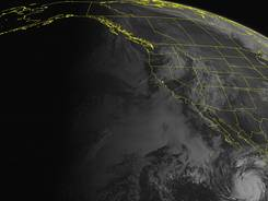 NOAA satellite image taken Sept. 23, 2012, at 11 a.m. EDT shows Miriam in the bottom right, south of Baja California, moving north.