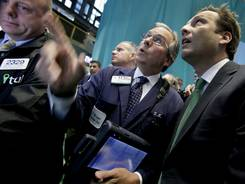 Trulia CEO Pete Flint, right, talks with trader Thomas Kay on the floor of the New York Stock Exchange, Sept. 20, 2012.