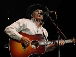 George Strait performs during the Fire Relief, The Concert For Central Texas in Austin.