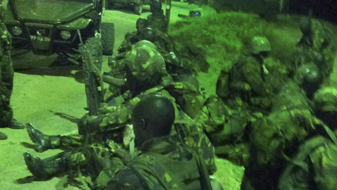 Kenyan troops engage in recent preparations for an assault on the Somali port city of Kismayo.