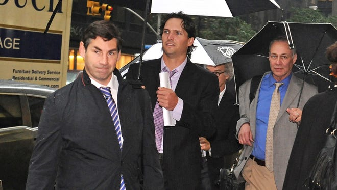 Matthew Schneider, left, special assistant to NHL Players Association executive director Donald Fehr, Winnipeg Jets' Ron Hainsey, center,  and Steve Fehr, players union special counsel, arrive at NHL headquarters in New York on Friday.