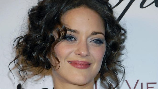 """Actress Marion Cotillard poses on the press line in 2008 at a party honoring her for an Academy Award nomination for best actress in the film """"La Vie En Rose."""""""