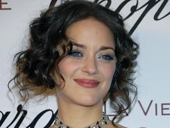 "Actress Marion Cotillard poses on the press line in 2008 at a party honoring her for an Academy Award nomination for best actress in the film ""La Vie En Rose."""