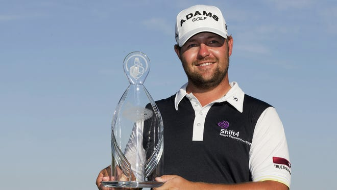 Ryan Moore holds up the trophy after winning the Justin Timberlake Shriners Hospitals for Children Open.