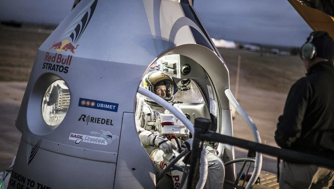 Daredevil Felix Baumgartner of Austria sits in his capsule during the preparation for the final manned flight of Red Bull Stratos in Roswell, N.M. on Saturday.