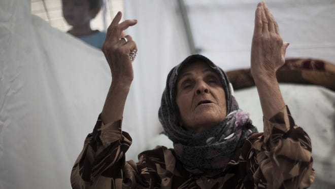 An elderly Syrian refugee fled her home with her family due to fighting between government forces and rebels.