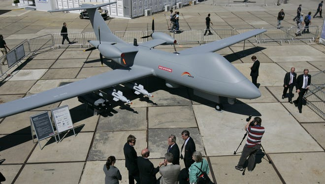 Visitors walk around a Mantis unmanned aircraft by BAE Systems at the Farnborough aerospace show, in England in this 2008 file photo.