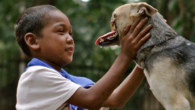 Kabang the dog lost its snout while saving two girls in the Philippines.