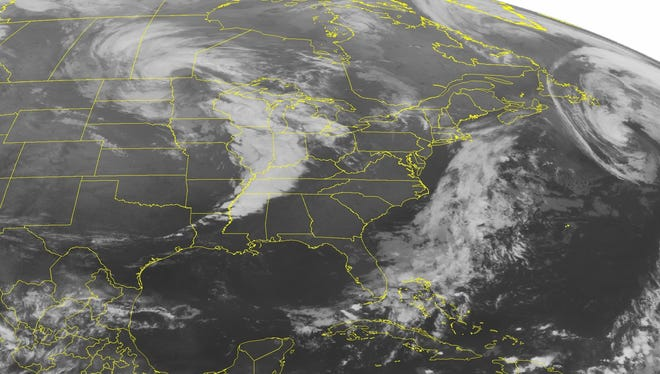 A satellite image from early Thursday shows a line of strong and severe thunderstorms along a cold front moving into the Ohio and Tennessee Valleys.