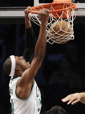 Celtics forward Paul Pierce dunks in Thursday's preseason win against the Nets.