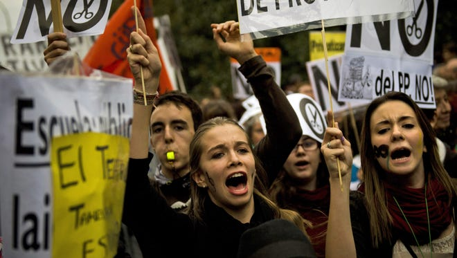 Students protest during a demonstration against education cuts in the street in Madrid on Oct. 18.