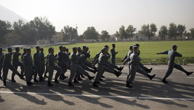 Recruits exercise in formation at the National Police Academy in Kabul, Afghanistan, in Oct.