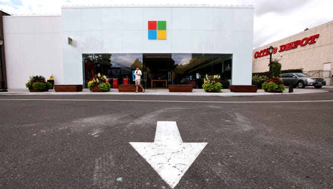The new Microsoft logo is seen above the entrance to a company store in Seattle.