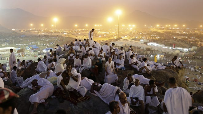 Muslim pilgrims pray on a rocky hill called the Mountain of Mercy on the Plain of Arafat near the holy city of Mecca, Saudi Arabia, in the early morning Thursday.
