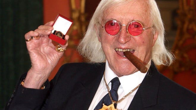 Sir Jimmy Savile, who for decades was a fixture on British television, poses for a photo in March 2008.