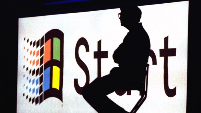 In this Aug. 24, 1995, file photo, Microsoft Chairman Bill Gates sits on stage during a video portion of the Windows 95 Launch Event  on the company's campus in Redmond, Wash.