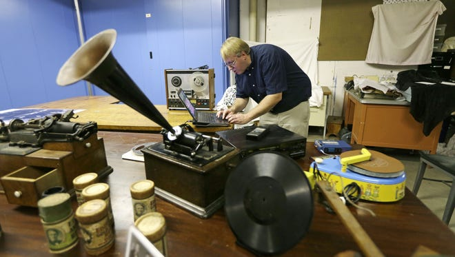 Chris Hunter, curator at the Museum of Innovation and Science, plays a 1878 tinfoil recording on a computer.