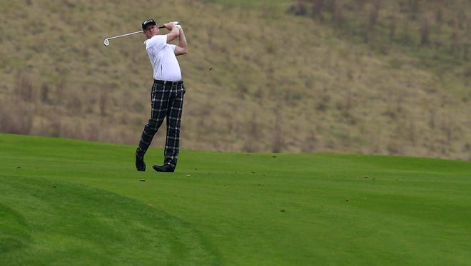 Jamie Donaldson of Wales hits a shot on the 18th fairway during the first round of the BMW Masters in Shanghai, China.