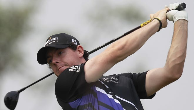 Rory Mcllroy of Northern Ireland tees off during the second round of the BMW Masters.
