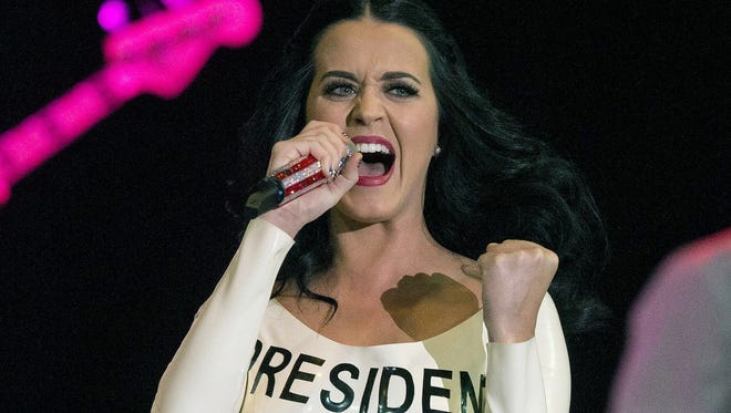 Katy Perry performs for a crowd before the arrival of President Barack Obama in Las Vegas