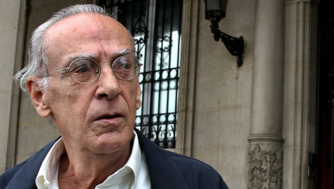 Cuban opposition leader and former prisoner Eloy Gutierrez-Menoyo stands outside the entrance to the Spanish Embassy, in Havana, Cuba, in 2005.