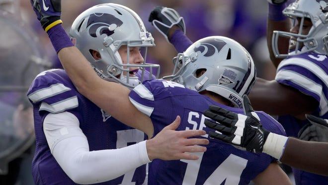 Kansas State quarterback Collin Klein, left, celebrates a touchdown Saturday in a rout of Texas Tech.