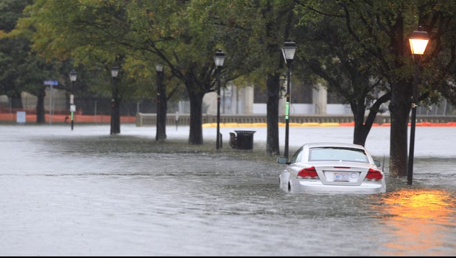 A stranded car sits along a street near downtown Norfolk, Va., Oct. 29, 2012, as rain and wind from Hurricane Sandy hit the area.