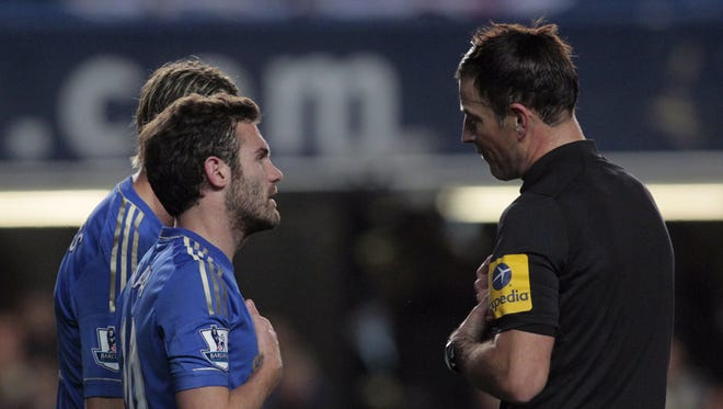 Chelsea's Juan Mata, left, speaks to referee Mark Clattenburg during Sunday's controversial 3-2 loss to Manchester United.