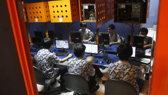 Indonesian students browse the internet at a cafe in Jakarta, Indonesia, Oct. 19.
