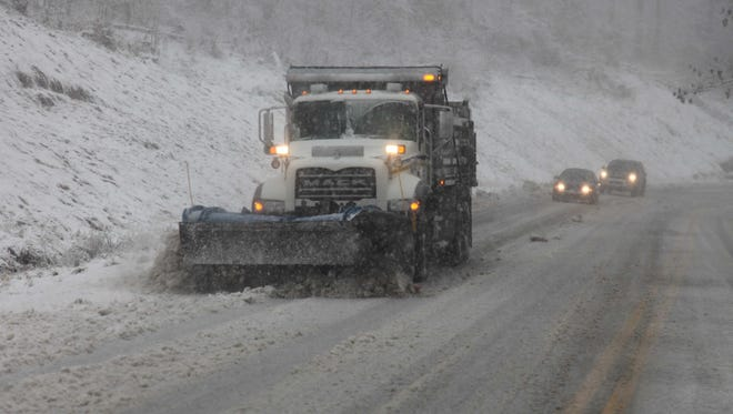 A snow plow thundered through the mountains of West Virginia as the superstorm began its raking of the region on Monday evening.