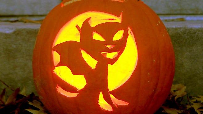 A carved pumpkin is displayed.