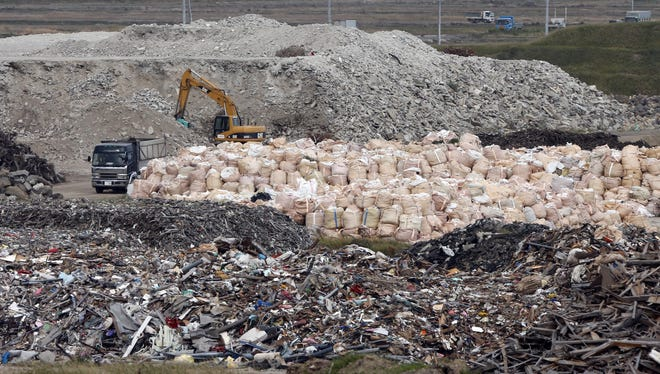 A yellow crane sorts rubble of the 2011 earthquake and tsunami in Sendai, Japan, this month.