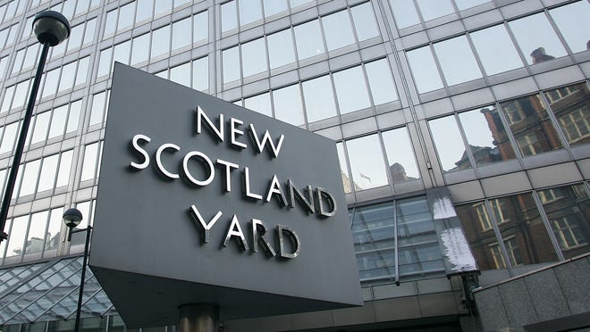 New Scotland Yard, the headquarters building of the Metropolitan Police, with its sign.