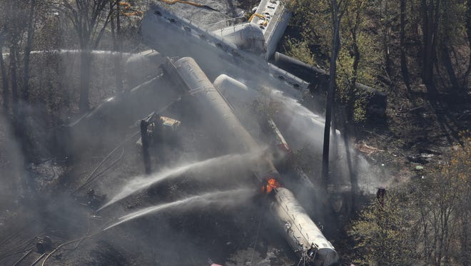 Flames can be seen from the air after an explosion happened at the sight of a train derailment in southern Jefferson County, just south of Louisville, Ky, Wednesday.