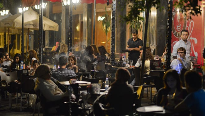 Egyptians relax outside a cafe in Cairo on  Wednesday.