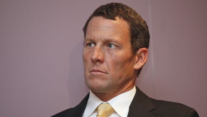 The IOC formally opened an investigation that could result in Lance Armstrong losing his Sydney Olympics bronze medal for doping. AOC president John Coates wants future members to a sign a declaration of no past doping.