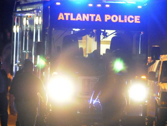 Law enforcement personnel investigate the scene of an Atlanta Police Department helicopter crash early Sunday.