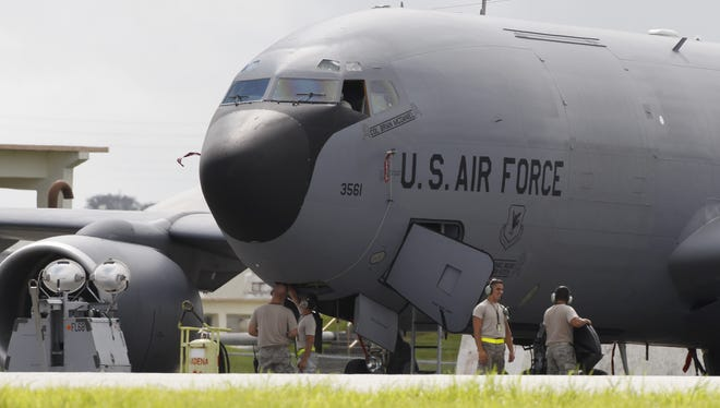 Ground crew members work on a U.S. Air Force KC-135 Stratotanker at Kadena Air Base on Japan's southwestern island of Okinawa.