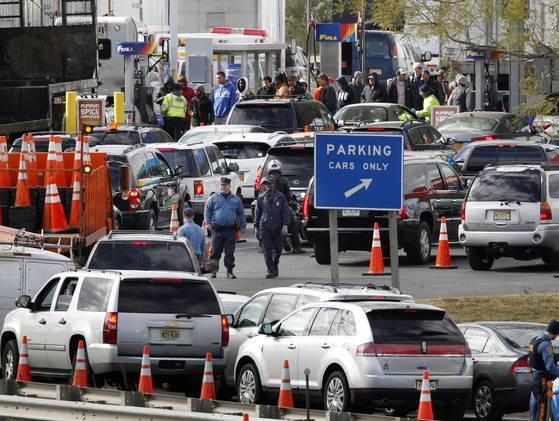 New Jersey state troopers keep order as motorist line up to purchase gasoline at the Thomas A. Edison service area on the New Jersey Turnpike.