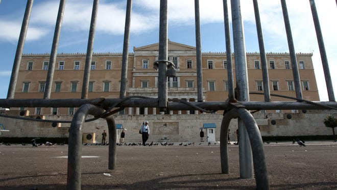 Police fences protect the Greek parliament, ahead of the three days of union strikes.