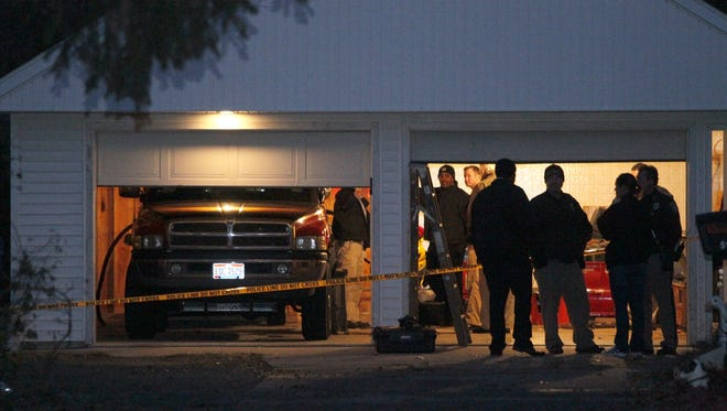 Authorities respond to a report of carbon monoxide poisoning on Harvest Lane in Toledo, Ohio, on Monday.