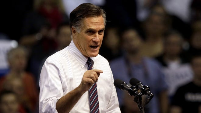 Mitt Romney speaks at a campaign event in Manchester, N.H.