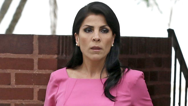 Jill Kelley leaves her home in Tampa, Fla., Tuesday.