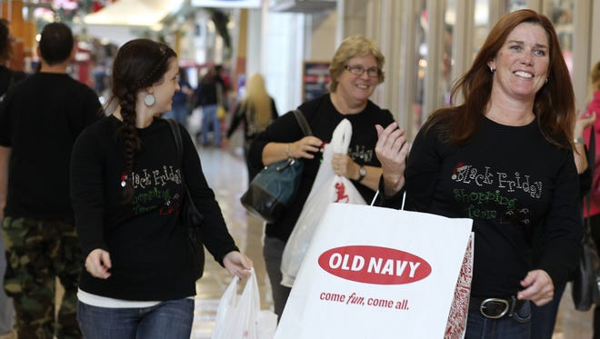 Sheree Paloutzian, from right, her mother, Raelene Macdowell, and sister Sydnee Crawford, make their way through the Mt. Shasta Mall in Redding, Calif., on Friday.