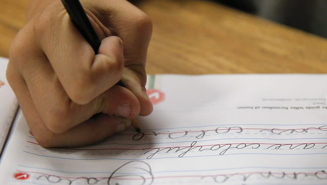 A student practices writing in cursive at St. Mark's Lutheran School in Hacienda Heights, Calif., Oct. 18, 2012.