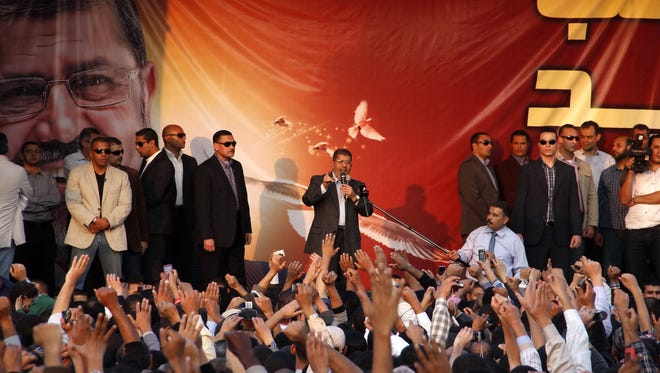 Egyptian President Mohammed Morsi speaks to supporters outside the Presidential palace in Cairo, Egypt, Friday.