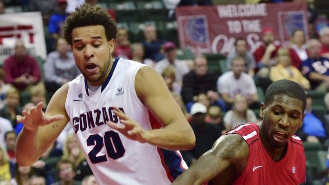 Gonzaga forward Elias Harris, left, scored 24 points to help the Bulldogs claim the Old Spice Classic title.
