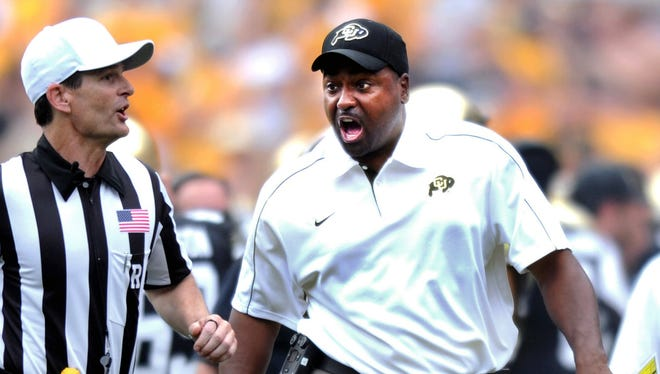 Colorado coach Jon Embree, right, suggested that he needed to take shortcuts in order to turn the football program around.